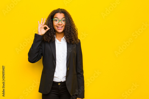 Fotografie, Obraz  black business woman feeling successful and satisfied, smiling with mouth wide o