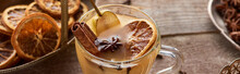 Selective Focus Of Pear Mulled Wine With Spices And Dried Citrus On Wooden Table, Panoramic Shot