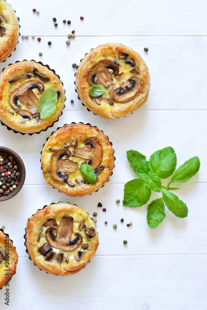 Fototapety, obrazy: Tartlets with mushrooms and chicken on a wooden background. View from above.
