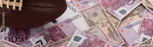 panoramic shot of rugby ball on euro and dollar banknotes, sports betting concep Wallpaper Mural