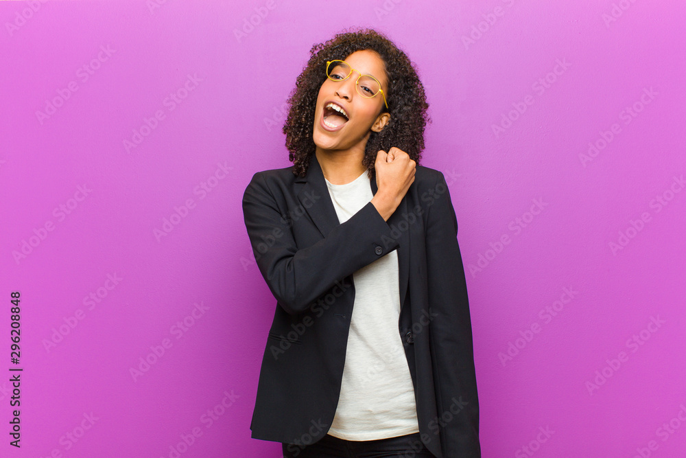 Leinwandbild Motiv - kues1 : young black business woman feeling happy, positive and successful, motivated when facing a challenge or celebrating good results