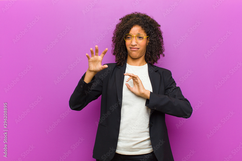Leinwandbild Motiv - kues1 : young black business woman feeling disgusted and nauseous, backing away from something nasty, smelly or stinky, saying yuck