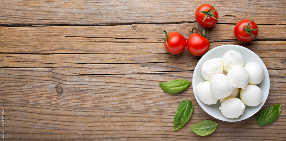 Fototapety, obrazy: Small mozzarella balls, cherry tomatoes and basil. Top view, space for text.