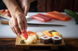 canvas print picture - japanese sushi chef making nigiri sushi