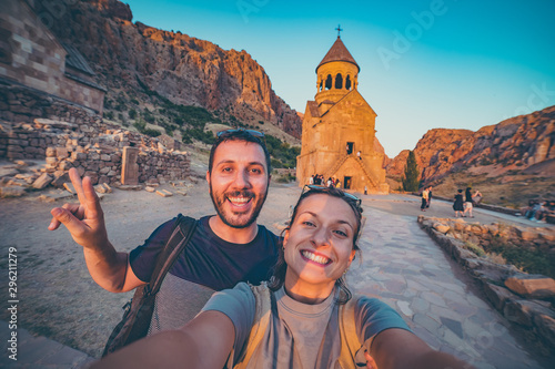 Photo Stands Cappuccino Noravank monastery, Armenia. Happy couple travelling in Armenia taking selfie in Novarank