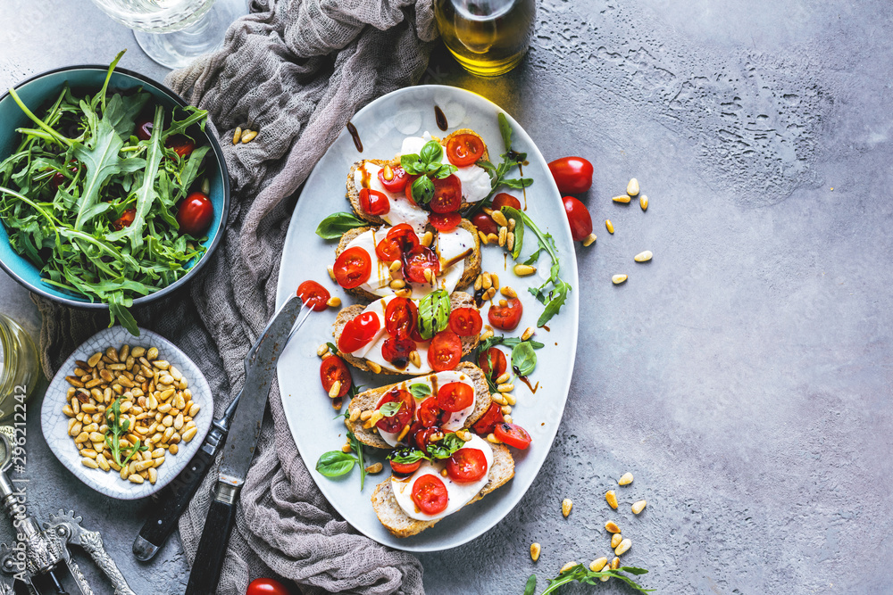 Fototapety, obrazy: Italian bruschetta with chopped tomatoes, basil and mozzarella on grilled crusty bread