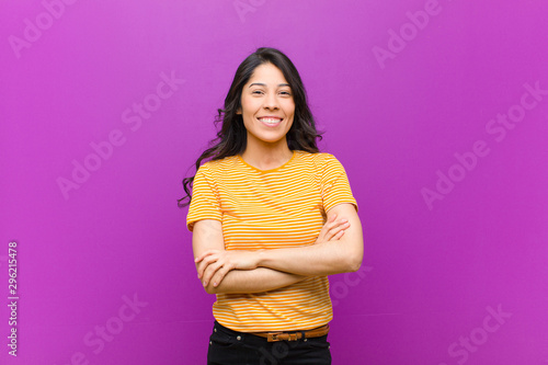 young pretty latin woman looking like a happy, proud and satisfied achiever smil Fototapet