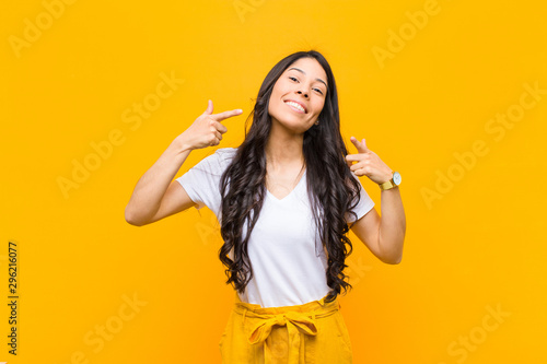 Tableau sur Toile young pretty latin woman smiling confidently pointing to own broad smile, positi