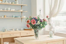Flowers In Vase On The Table A...