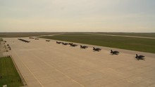 Military Aircraft Lined Up On Ramp From Tower
