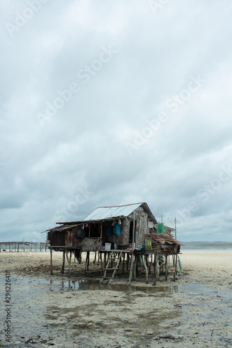 A stilt house on a beach during lowtide in Tawi-Tawi in the Philippines Wallpaper Mural