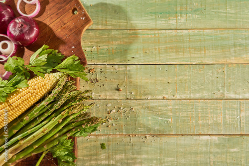 asparagus on rustic board. top view. negative space for text Canvas Print