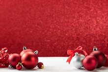 Christmas Balls On White Table Red Wall