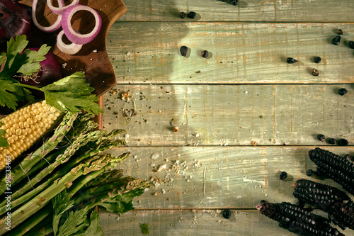 asparagus on rustic board with onions and black corn Canvas Print