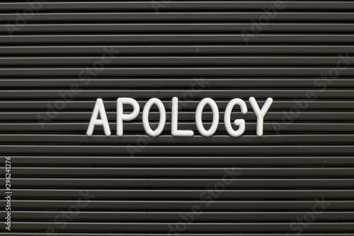 Black color felt letter board with white alphabet in word apology background Wallpaper Mural