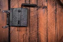 Old Rusty Door Handle In A Woo...