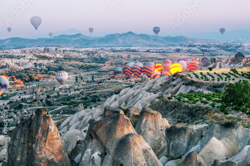 Foto auf Gartenposter Blau Jeans Ignition and take-off of balloons in Cappadocia