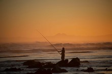 Fisherman At Sunset On Maitland Beach, South Africa