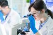 Leinwandbild Motiv Asian scientist use microscope