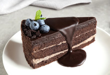 Delicious Fresh Chocolate Cake With Blueberries On Light Table, Closeup