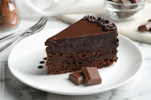 obraz lub plakat Delicious fresh chocolate cake served on white marble table