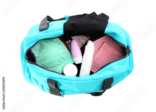 Sport bag with deodorants and clothes on white background, top view Wallpaper Mural