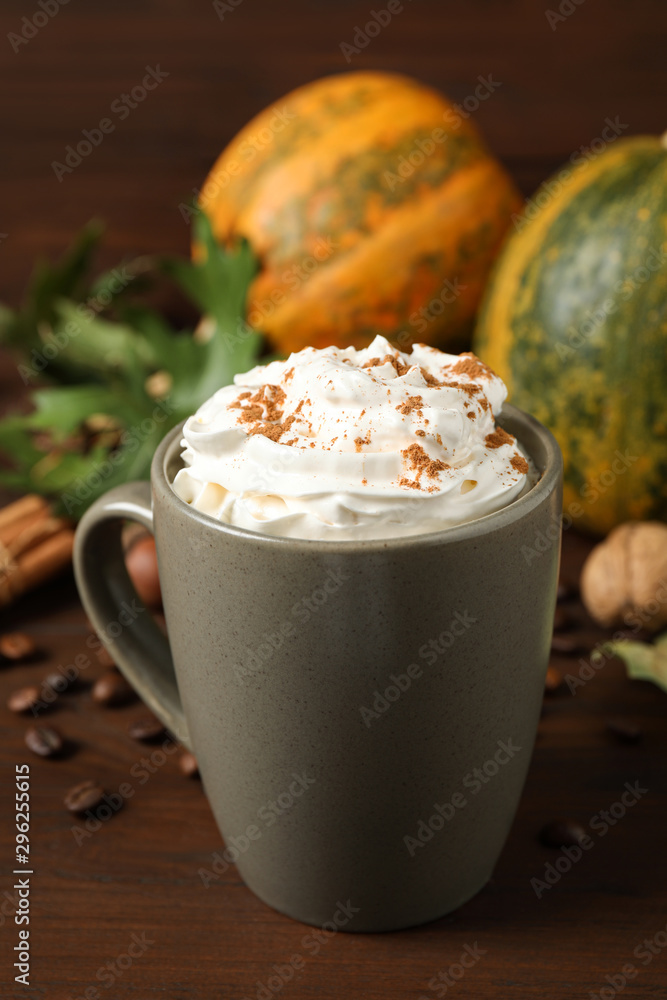 Fototapeta Cup with tasty pumpkin spice latte on wooden table