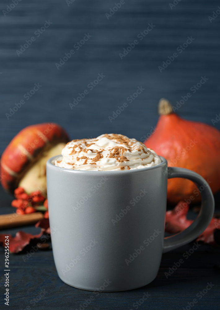 Fototapeta Cup with tasty pumpkin spice latte on blue wooden table