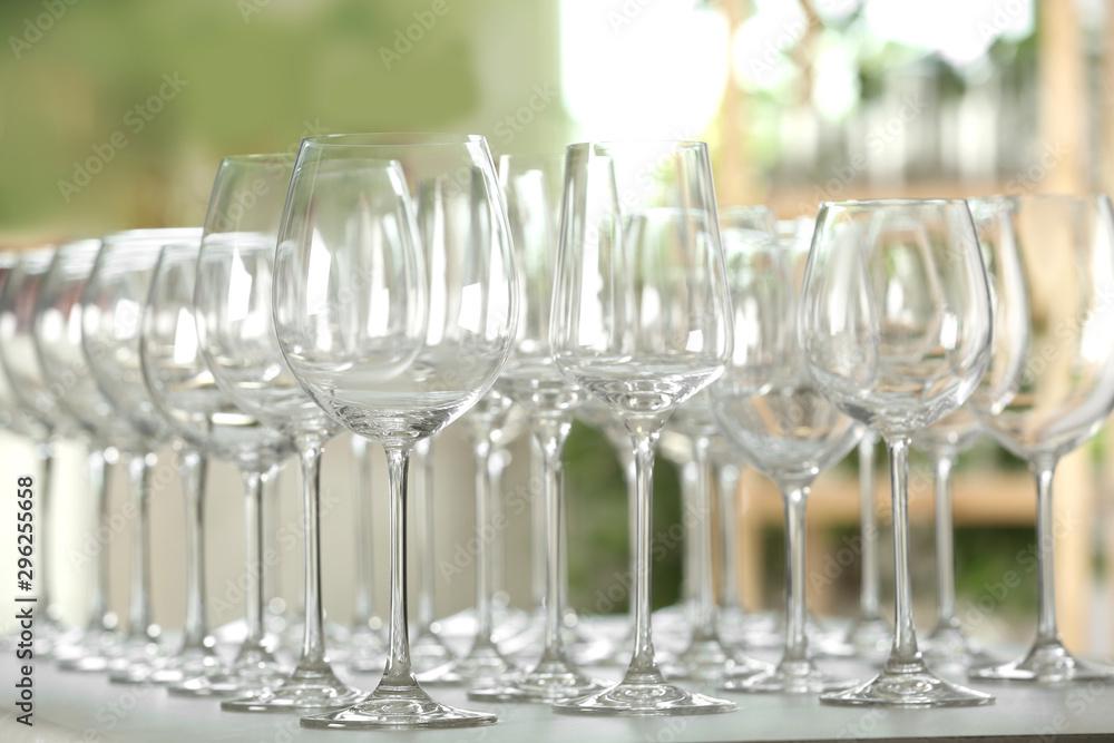 Fototapeta Empty glasses on table against blurred background