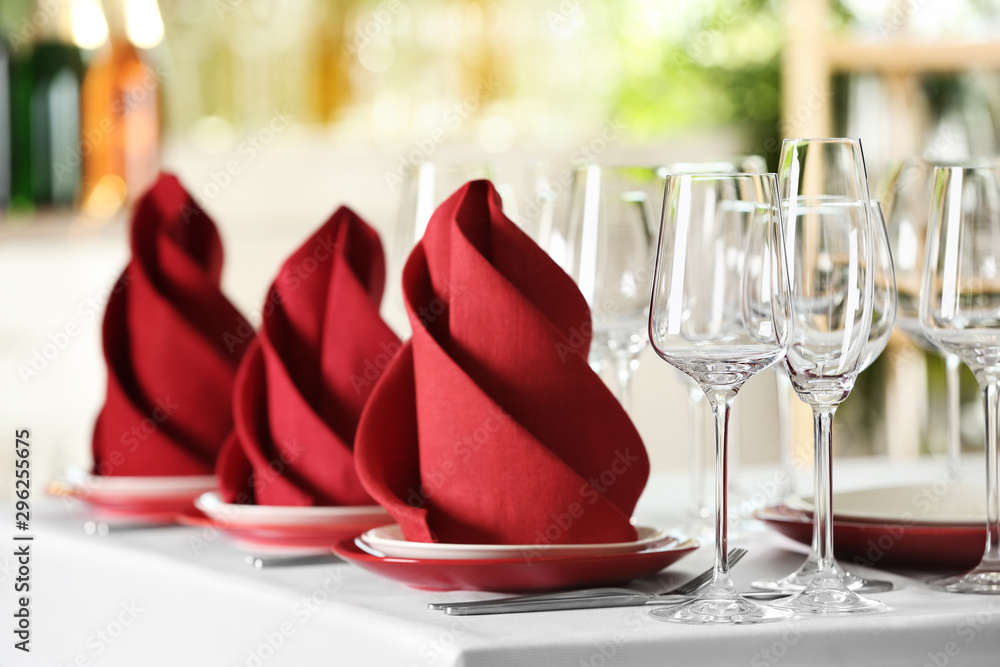 Fototapeta Table setting with empty glasses, plates and cutlery on table