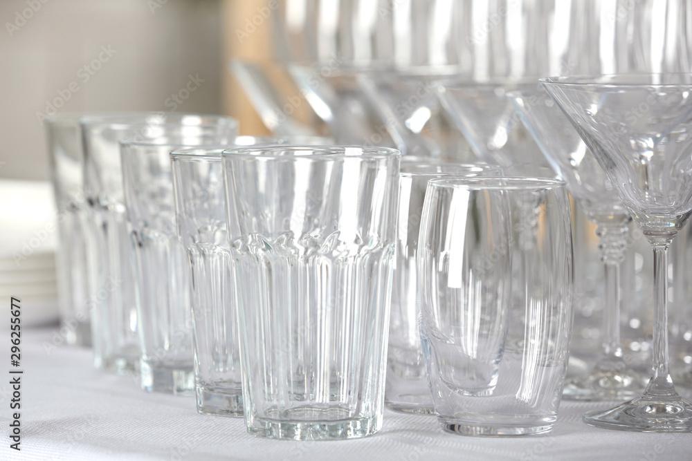 Fototapeta Set of empty glasses on table indoors