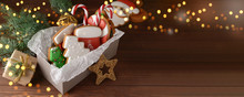 Box With Tasty Christmas Cookies On Wooden Table