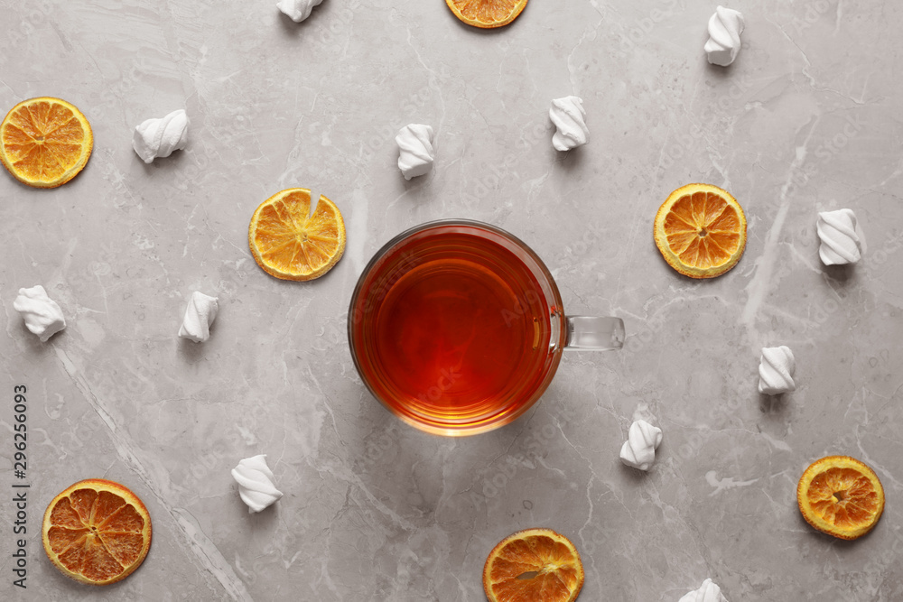 Fototapeta Flat lay composition with cup of tea on grey marble table. Cozy winter