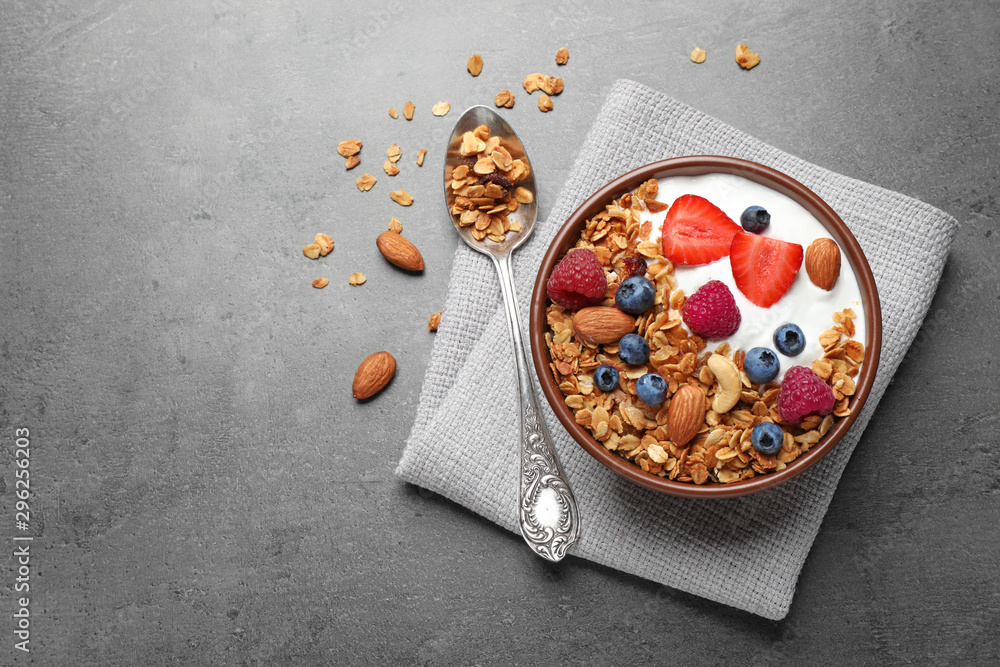 Obraz Tasty homemade granola  served on grey table, flat lay with space for text. Healthy breakfast fototapeta, plakat