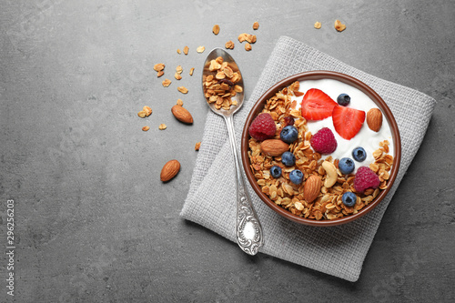 Foto Tasty homemade granola  served on grey table, flat lay with space for text