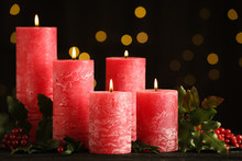 Burning Red Candles With Holly...
