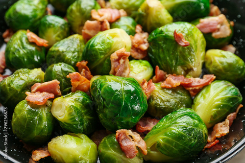 Recess Fitting Brussels Frying pan of tasty roasted Brussels sprouts with bacon, closeup