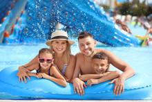 Happy Family Resting In Aqua P...