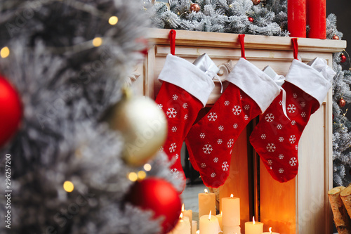 Fireplace with Christmas stockings in festive room interior Canvas-taulu