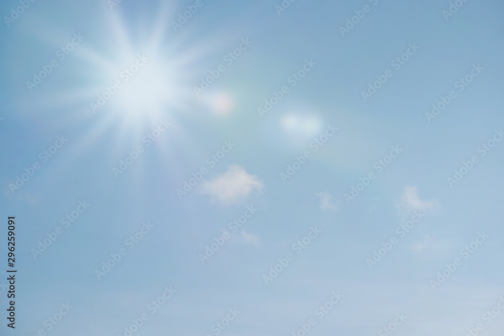 Fototapety, obrazy: Blue sky with sun reflection. Sunny background. Sun appear directly above Thailand. The afternoon summer sun shines on a beautiful sky with clouds.
