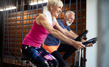 Vital Mature Couple Exercising...