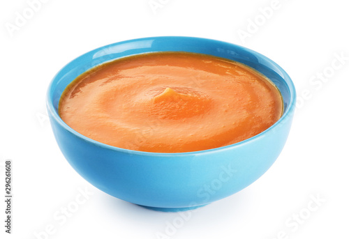 Pumpkin cream soup isolated on white background.