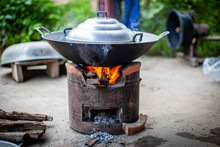 Aluminum Steamer Pot With Big Black Pan On Firewood Burning Stove
