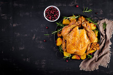 Baked Turkey Or Chicken. The Christmas Table Is Served With A Turkey, Decorated With Bright Tinsel. Fried Chicken. Table Setting. Christmas Dinner. Top View