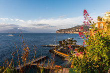 The Beautiful Italian Town Of Sorrento Situated In The Bay Of Naples. Mount Vesuvius Can Be Seen In The Distance.