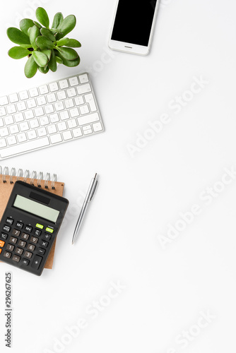 Elegant workspace with financial accessories isolated on white background with copyspace. Office desktop - 296267625