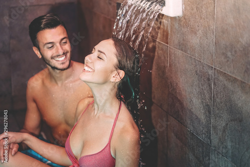 Recess Fitting Spa Happy couple having fun in luxury spa resort hotel - Romantic young people doing relaxing wellness waterfall treatment together - Love relationship and healthy well being lifestyle concept