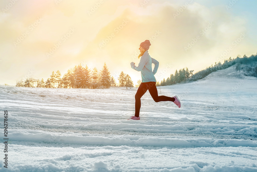 Fototapety, obrazy: Running woman. Runner on the snow in winter sunny day. Female fi