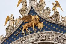 Venice, Closeup Of The Basilica And Cathedral Of San Marco (St. Mark The Evangelist), With The Golden Winged Lion. UNESCO World Heritage Site, Veneto, Italy, Europe