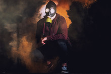A Man In A Mask Surrounded By Smoke In A Old Building. Horror / Halloween Concept